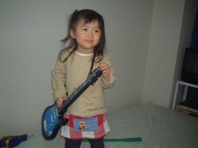 06-0324_nodoka_w_guitar.jpg